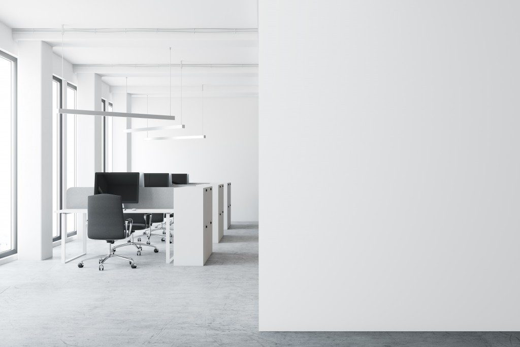 Well-lit office with white walls