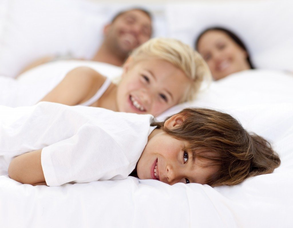 happy family on bed