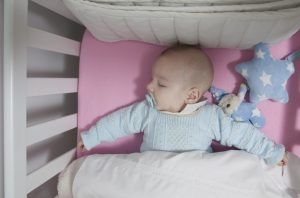 Baby sleepng in a crib