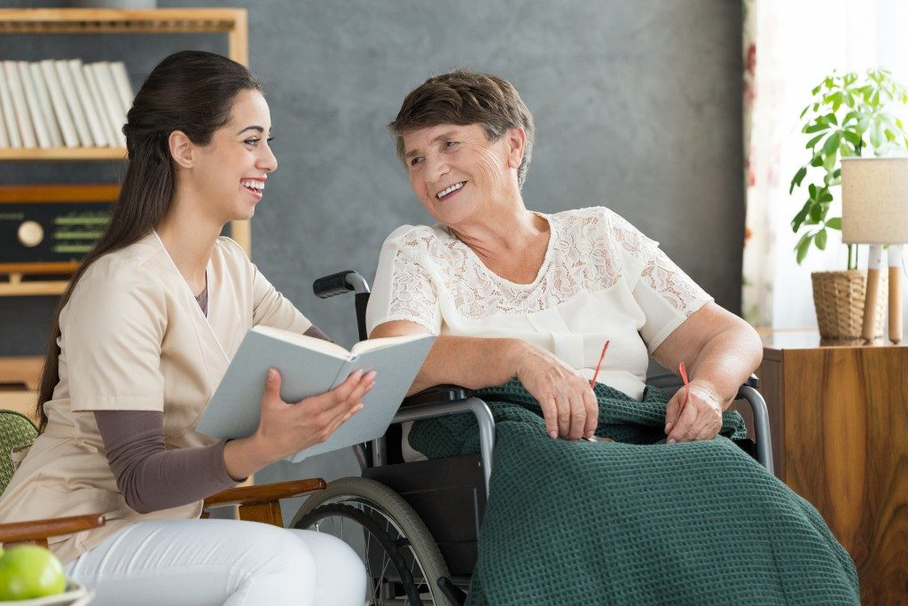 Woman having a conversation with an elderly woman