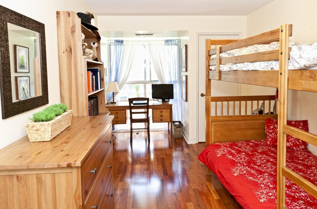bedroom with hardwood floor and bunk beds