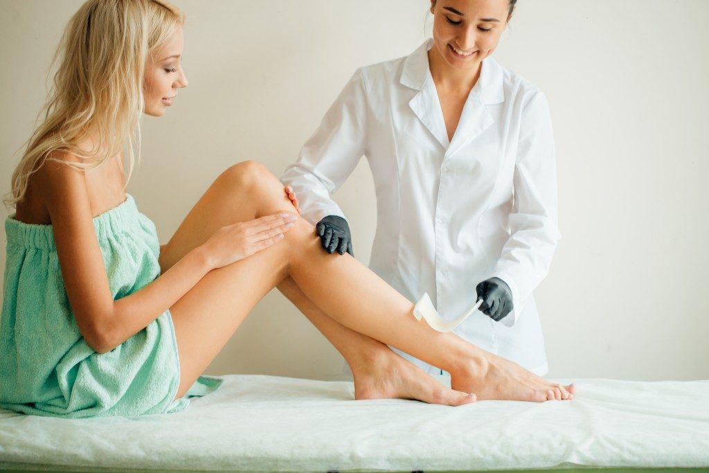 girl getting legs waxed