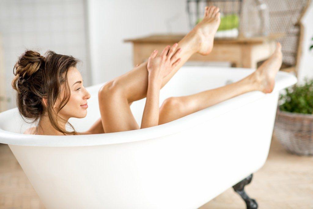 a woman in a bath tub