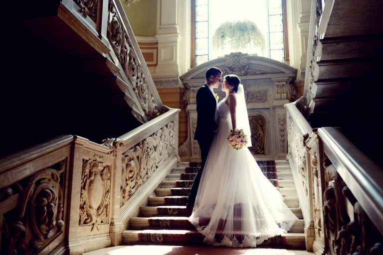 Bride and groom in a grand staircase