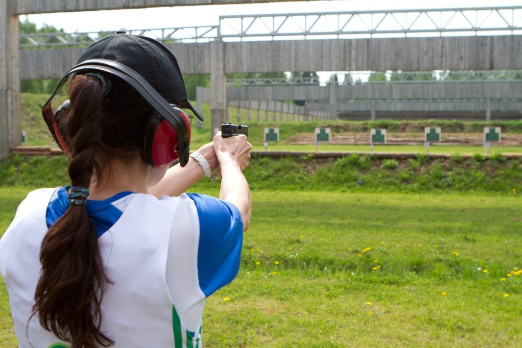 Woman practicing in the shooting range
