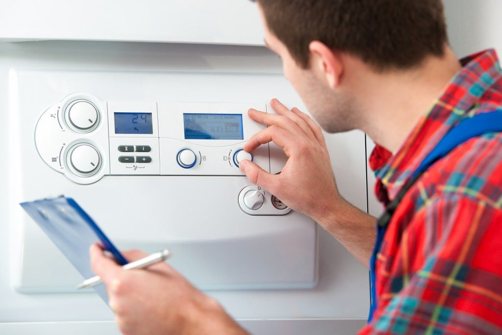 man checking home heating system