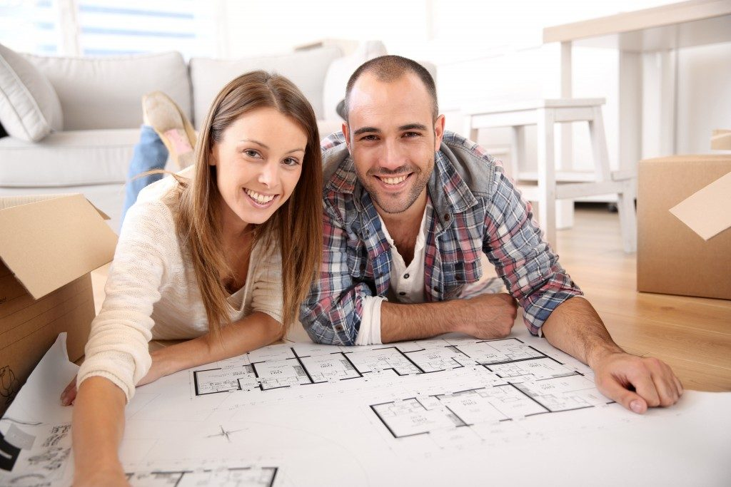Couple looking at house floor plan
