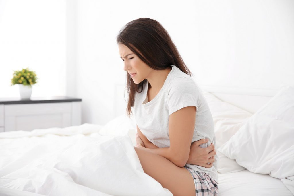 Young woman with stomachache