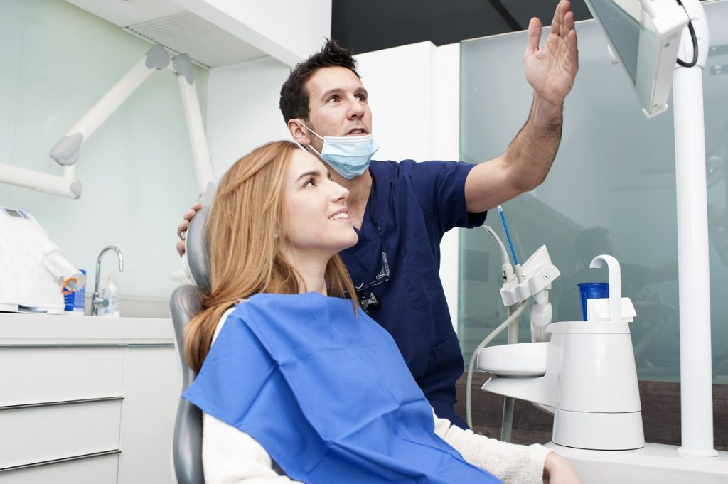 dentist showing patient result or process