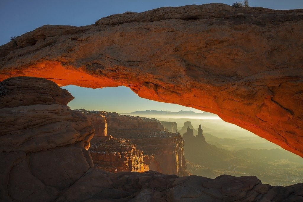 The sun rises at Mesa Arch in Canyonlands National Park, Utah