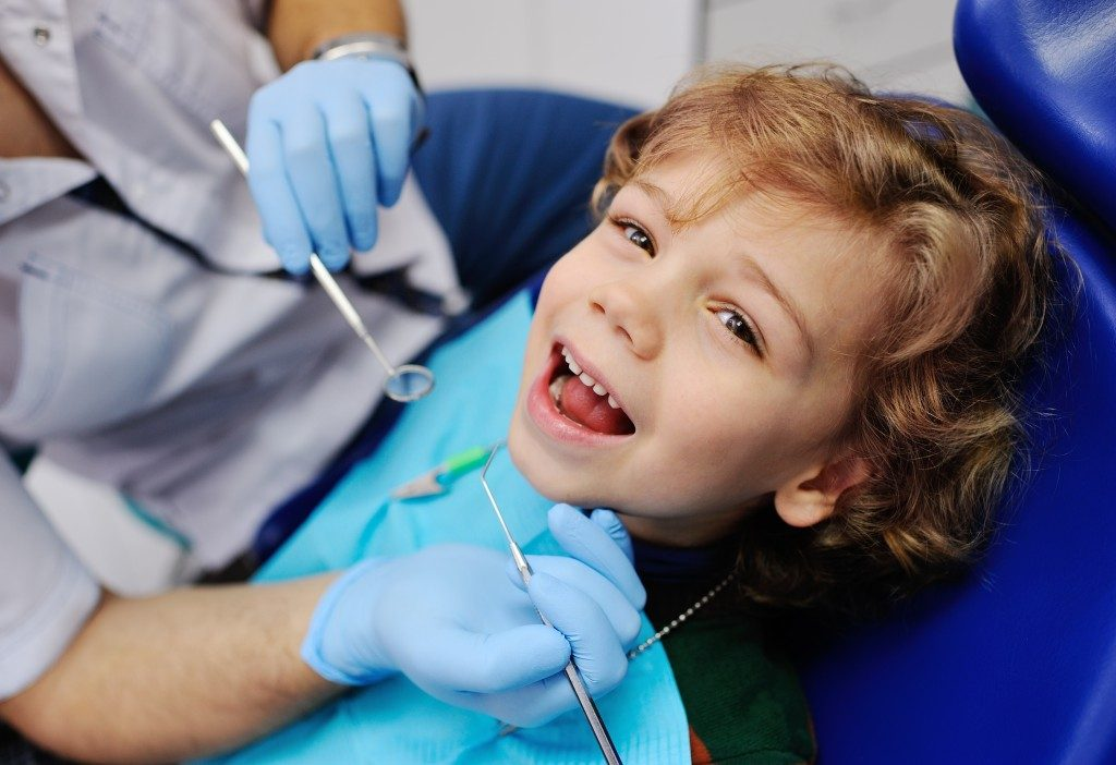 Happy kid in the dental clinic