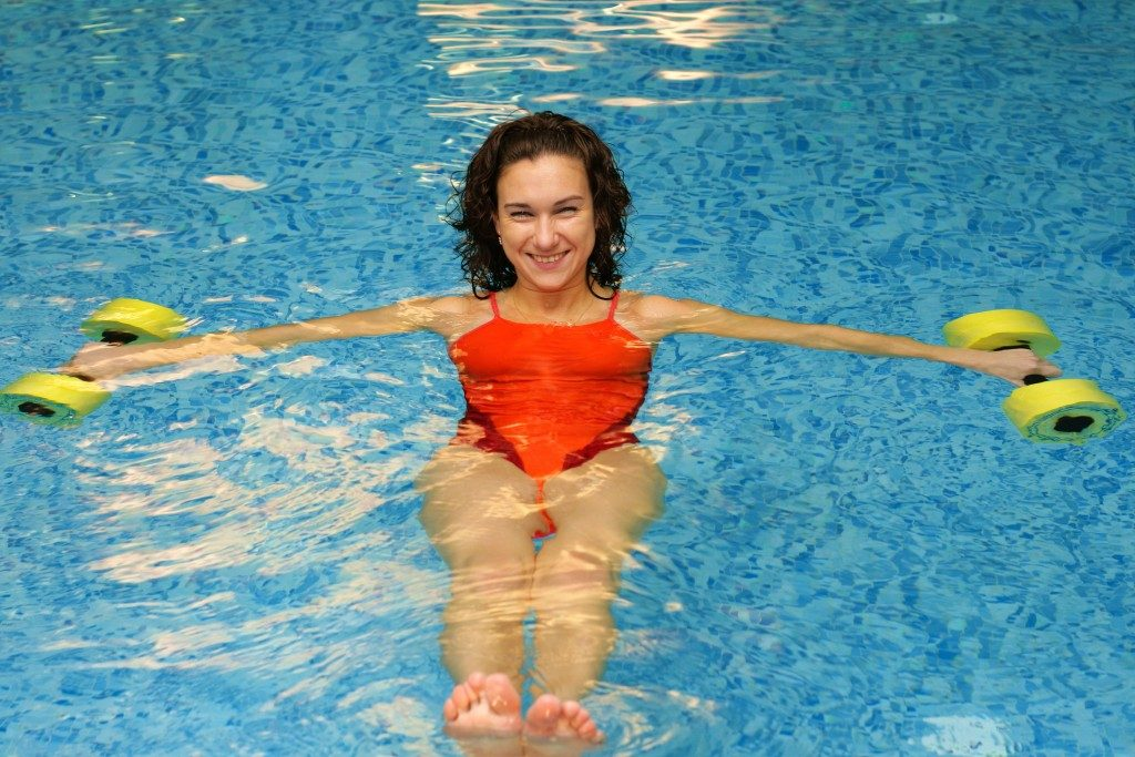 woman doing water exercise in a pool