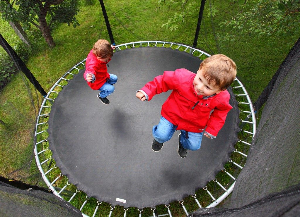 kids jumping on a trampoline