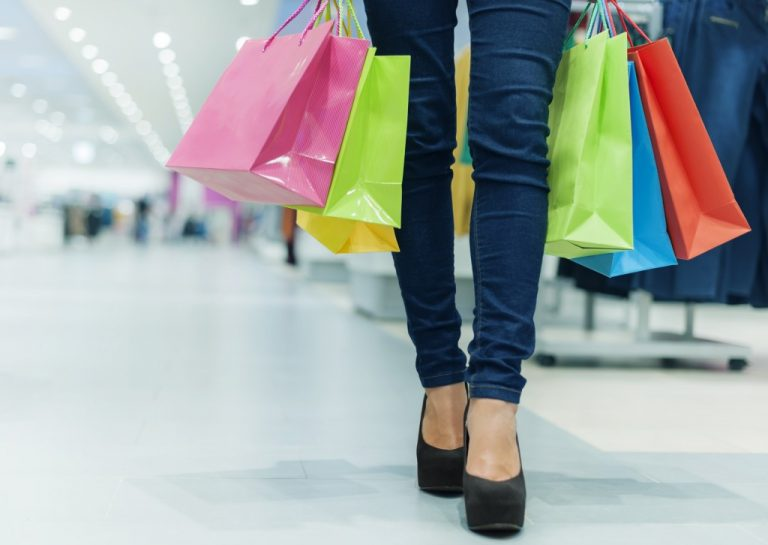 woman in heels with shopping bags