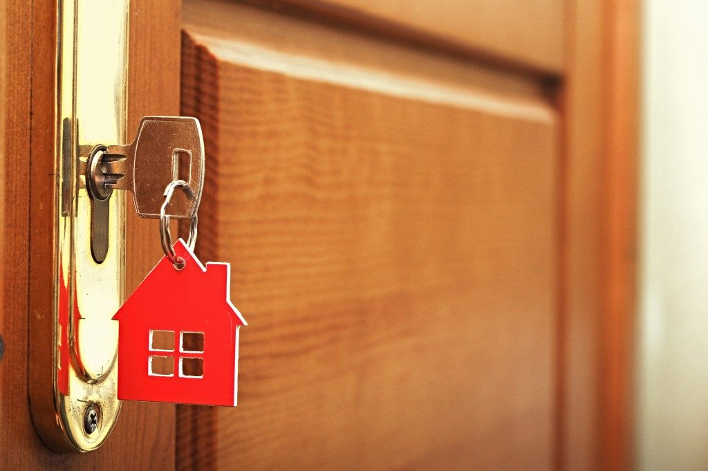 house key with a red house icon