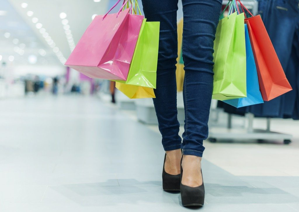 Female legs with shopping bags