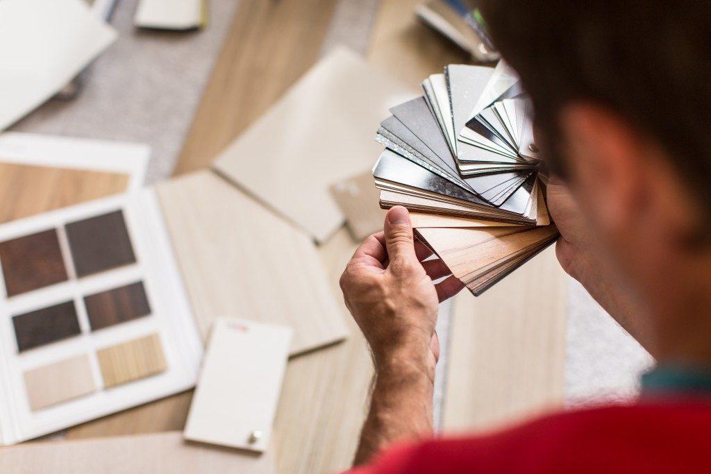 man choosing flooring material