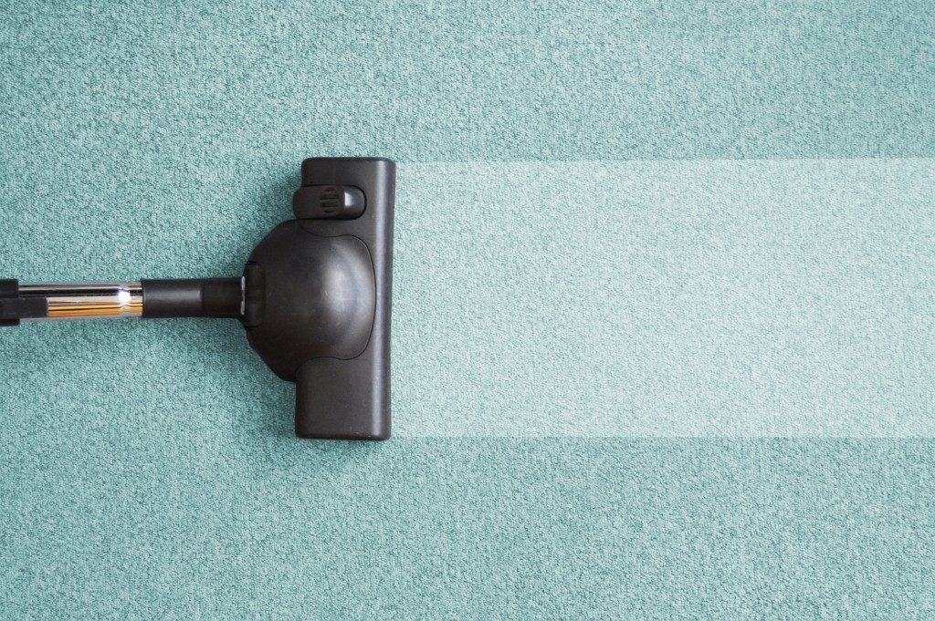 cleaning carpet with vacuum