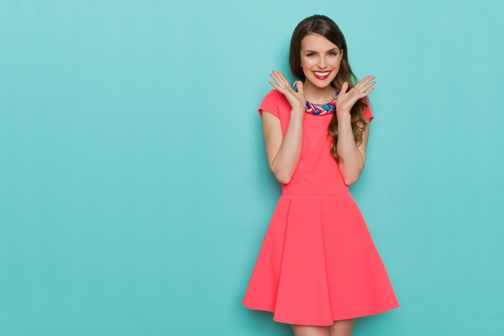 woman wearing a pink dress