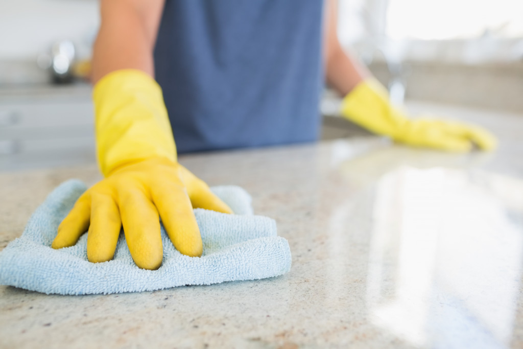 woman cleaning the countertop