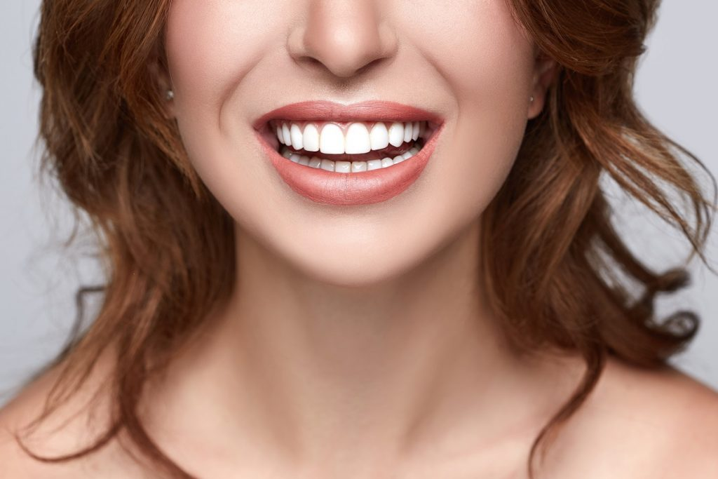 person with straight teeth