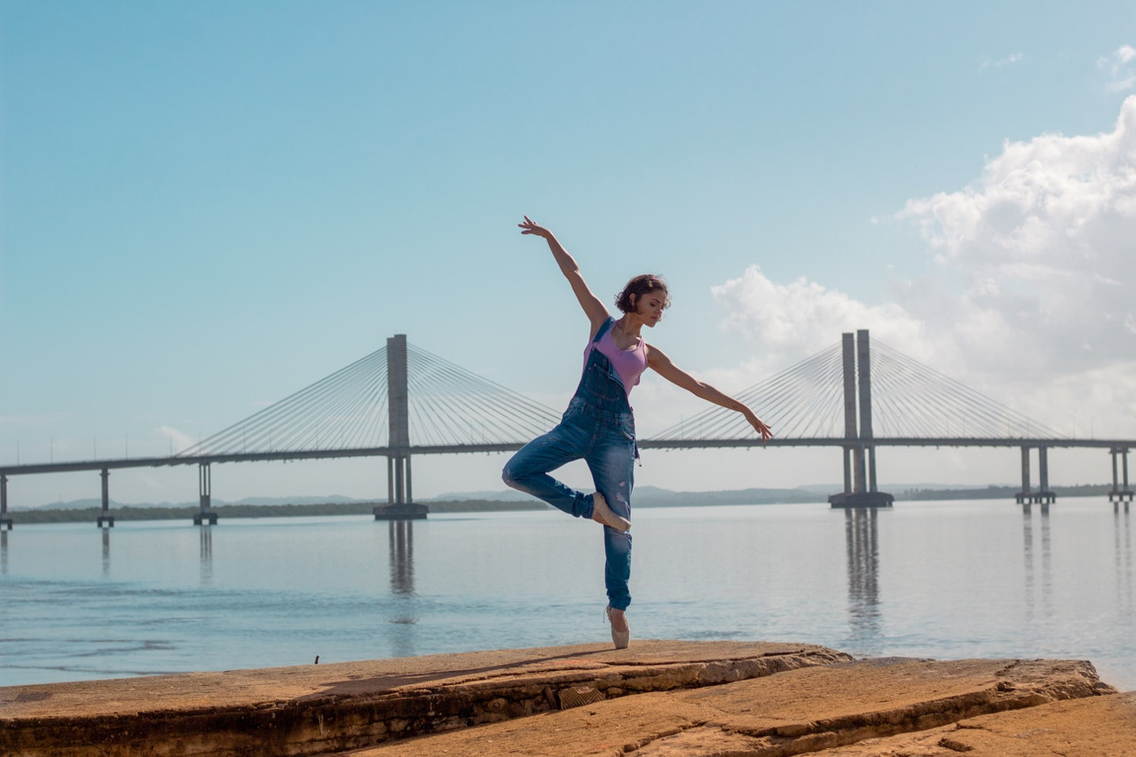 doing yoga by the coast