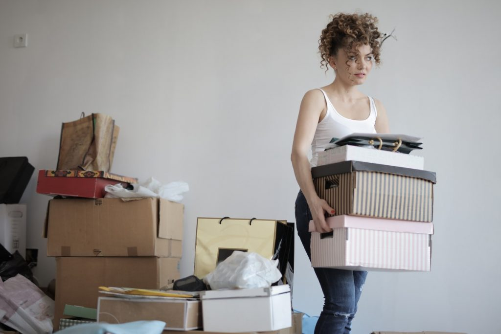 woman with many items in containers