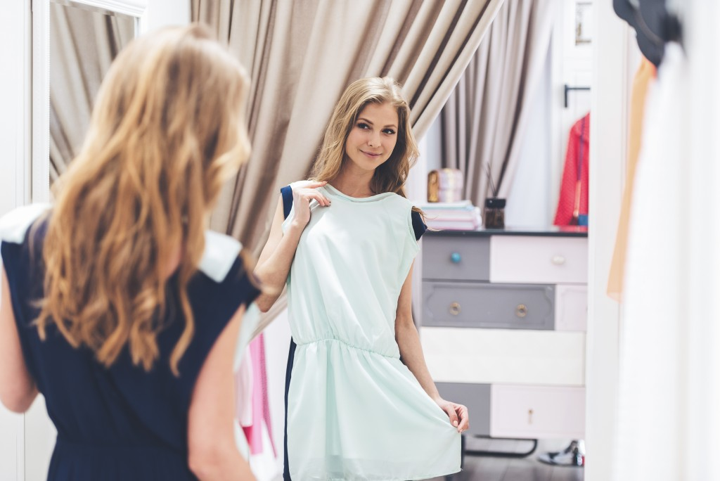 woman trying on dress