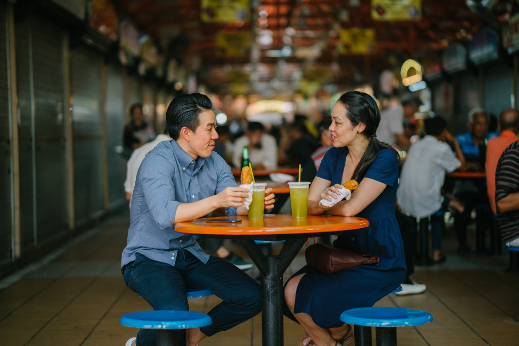 couple eating at a food court