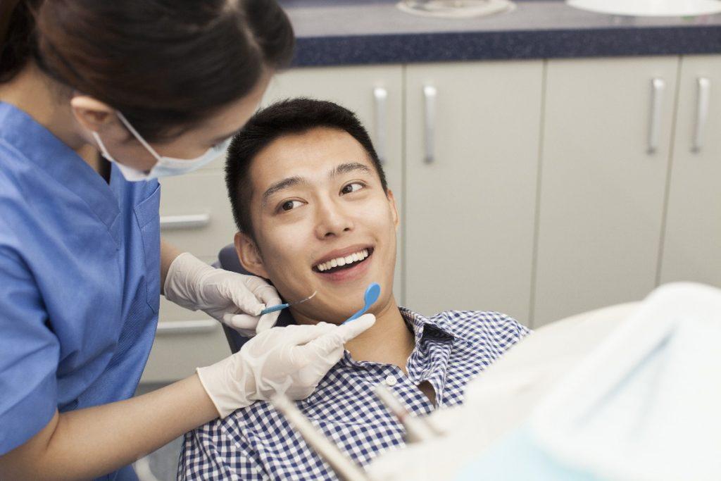 man at a dentist