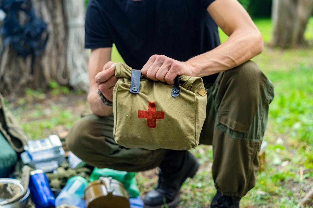 man holding emergency kit