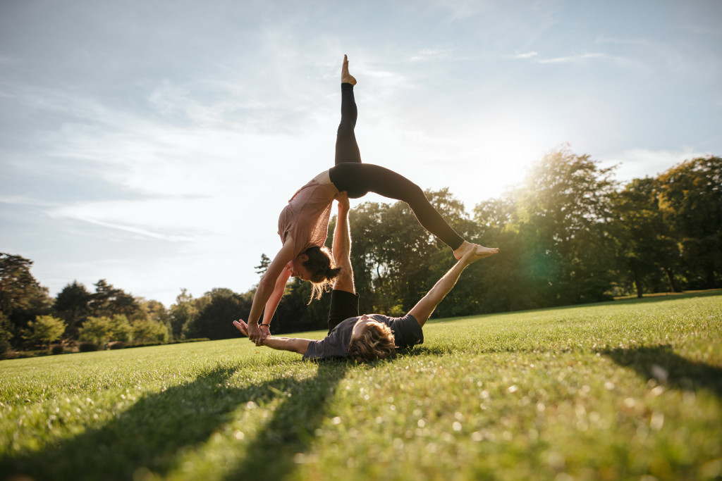 doing yoga in the park