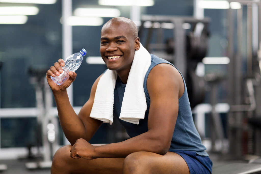 man resting after working out